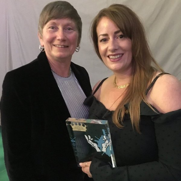 Rose Mahon, Head of Excellence and Development (left) and Katie Lewis, Exploitation Lead, collect the award for The Nelson Trust, nominated in the Social Care, Advice & Support category at this year's Charity Awards.